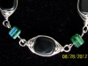Black with green cubes wire wrapped bracelet - $20